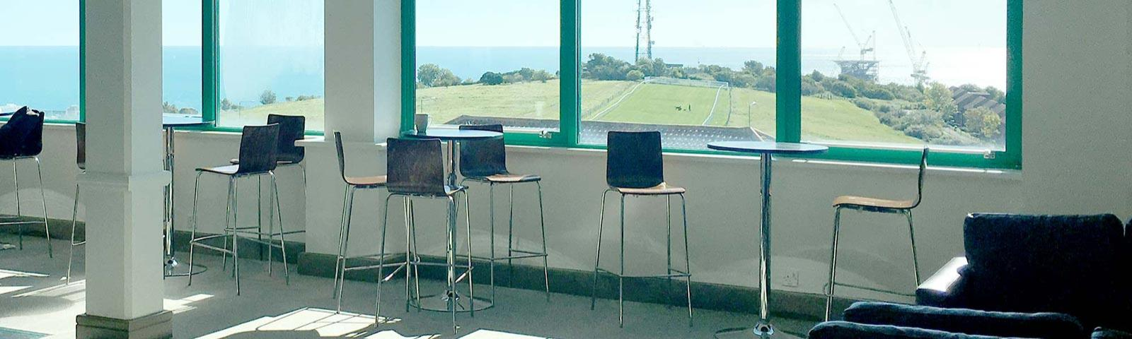 A view from inside Silks at Brighton Racecourse out over the course and over the English Channel.