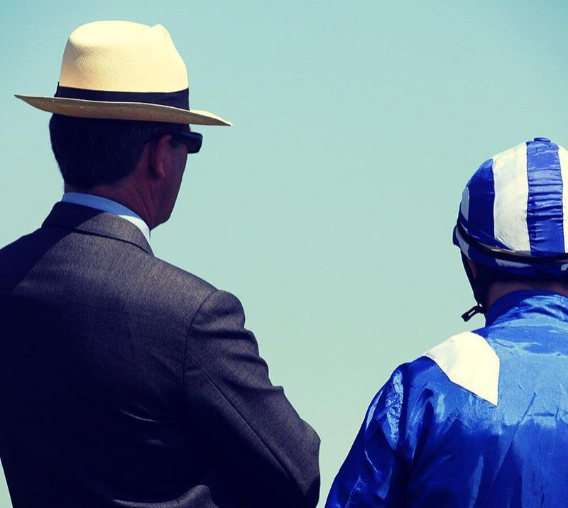 A trainer and Jockey take in the days activities.