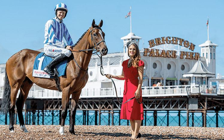 Horse and jockey in front of Brighton Pier