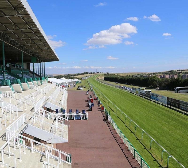 An external view from the grandstand at Brighton Racecourse on a beautiful Summers day.