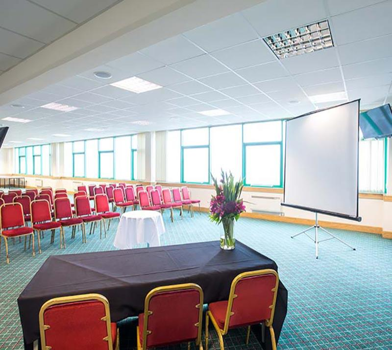 The Prince Regent suite at Brighton Racecourse prepared for a small meeting with presentation equipment.